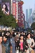 Pedestrians walk in Nanjing East Road, the most commercial shopping street in Shanghai, China, on November 24, 2009. Photo by Lucas Schifres/Pictobank