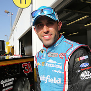 Sprint Cup Series driver Aric Almirola (43) smiles in his garage area during the 57th Annual NASCAR Coke Zero 400 practice session at Daytona International Speedway on Friday, July 3, 2015 in Daytona Beach, Florida.  (AP Photo/Alex Menendez)