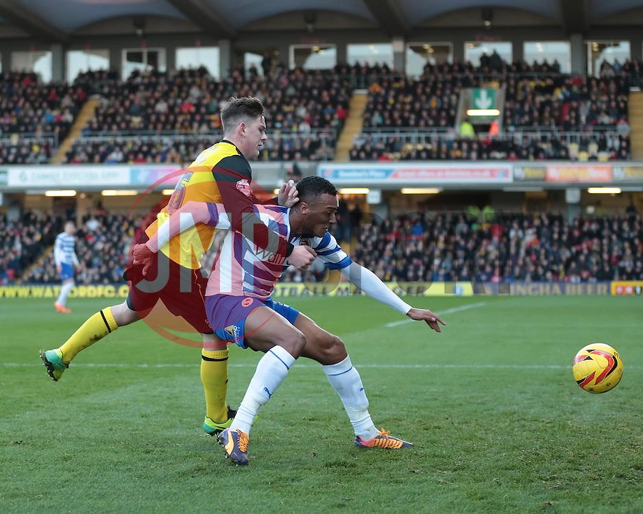 Reading's Jordan Obita is challenged by Watford's Sean Murray - Photo mandatory by-line: Nigel Pitts-Drake/JMP - Tel: Mobile: 07966 386802 11/01/2014 - SPORT - FOOTBALL - Vicarage Road - Watford - Watford v Reading - Sky Bet Championship