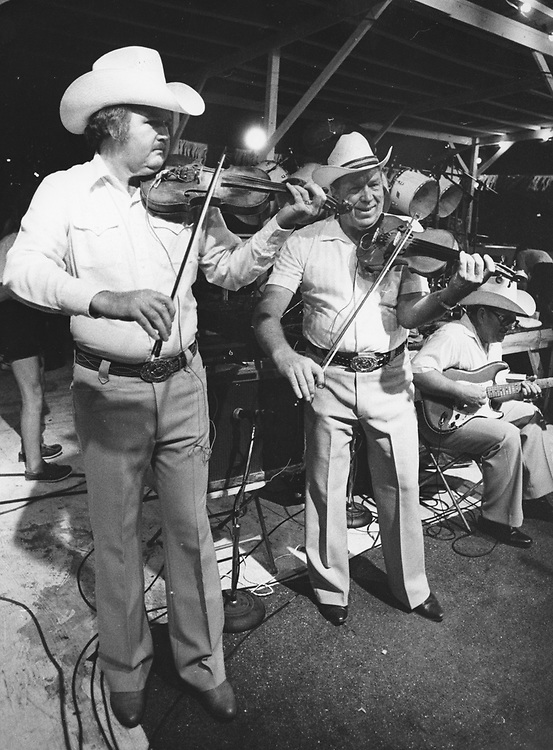 ©1980 The Original Texas Playboys in concert at an outdoor setting in Austin.
