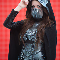 London, UK - 26 May 2013: Caitlin Smith dressed as Nightingale from the Skyrim poses for a picture during the London Comic Con 2013 at Excel London. London Comic Con is the UK's largest event dedicated to pop culture attracting thousands of artists, celebrities and fans of comic books, animes and movie memorabilia.