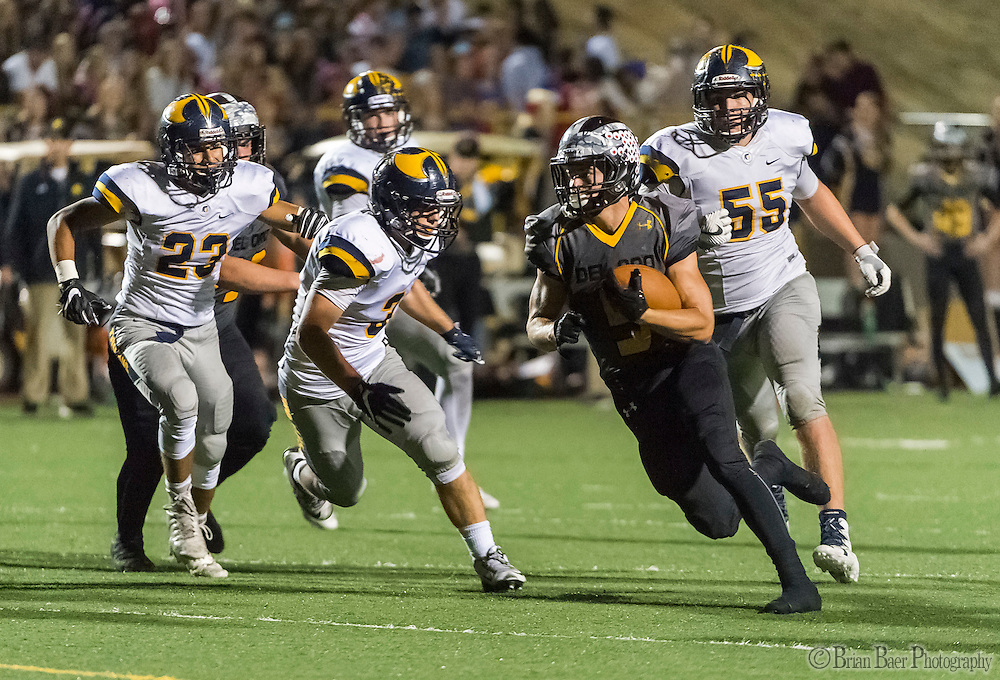 Del Oro Golden Eagle's Dalton Gee (5), runs for a touchdown to trail 27-25 after the point after attempt was good during the fourth quarter as the Del Oro Golden Eagles varsity football team host the Oak Ridge Trojans, Friday Oct 21, 2016.<br /> photo by Brian Baer