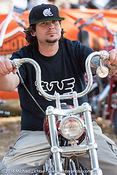 Chris Wade on his custom 1953 HD Panhead that won the Easyriders Magazine and Lowride Italy awards in the Harley-Davidson Editors Choice bike show at the Broken Spoke Saloon. Daytona Bike Week 75th Anniversary event. FL, USA. Wednesday March 9, 2016.  Photography ©2016 Michael Lichter.