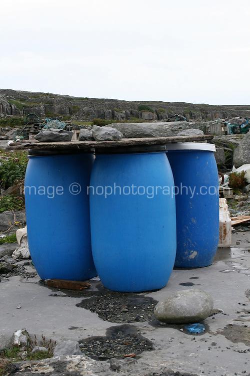 Three blue barrels on Inis Oirr the Aran Islands Galway Ireland