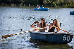 © Licensed to London News Pictures. 19/07/2016. London, UK. A man takes it easy with a bottle of champagne as his friends row him around the Serpentine lake in Hyde Park. Temperatures in the capital soared to 32 degrees celsius, the hottest day of the year so far. Photo credit: Rob Pinney/LNP