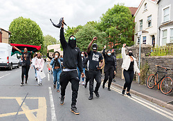© Licensed to London News Pictures; 04/06/2020; Bristol, UK. A Black Lives Matter march takes place through Bristol from Eastville Park to College Green, in memory of George Floyd a black man who was killed in the US by a white police officer kneeling on his neck for 9 minutes. Participants took the knee in respect at Eastville Park and then at College Green lay down with their hands behind their backs in front of City Hall to simulate being arrested. The killing of George Floyd has seen widespread protests in the US and other countries, despite the restrictions and social distancing due to the Covid-19 coronavirus pandemic. Photo credit: Simon Chapman/LNP.