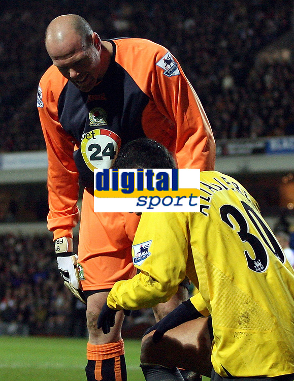 Photo: Paul Thomas.<br /> Blackburn Rovers v Arsenal. The FA Cup. 28/02/2007.<br /> <br /> Keeper Brad Friedel (R) has words to Arsenal's Jeremie Aliadiere (Yellow) after it was judged that Aliadiere had dived in the box and wasn't brought down by Friedel.