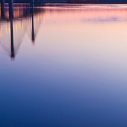 The Clark Bridge reflects in the Mississippi River at dawn in West Alton, Missouri.
