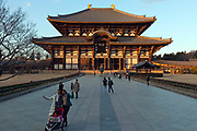 exterior of the Daibutsuden at the Todaiji temple complex during sunset with tourists Nara, Japan
