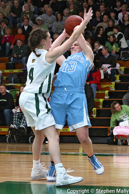 Jefferson's Rachel Broghammer (43) tries to pass the ball around Kennedy's Olivia Meier (4) during their game at Kennedy High School in Cedar Rapids on Friday January 8, 2010. Kennedy defeated Jefferson 66-46. (Stephen Mally/Freelance)