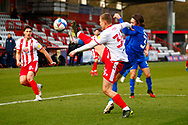 Luke Norris of Stevenage high kicks to pass the ball during the EFL Sky Bet League 2 match between Stevenage and Harrogate Town at the Lamex Stadium, Stevenage, England on 6 March 2021.