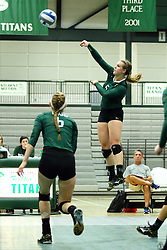 22 September 2015: Tyler Brown(5) strikes the ball as Maisy Bowden(6) runs a route  during an NCAA womens division 3 Volleyball match between the Augustana Vikings and the Illinois Wesleyan Titans in Shirk Center, Bloomington IL