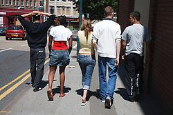 Teenagers walking down the street.