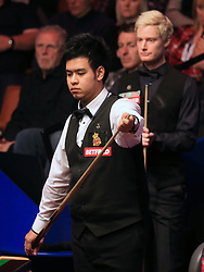 Neil Robertson (right) and Noppon Saengkham (front) and Neil Robertson on day five of the Betfred Snooker World Championships at the Crucible Theatre, Sheffield.