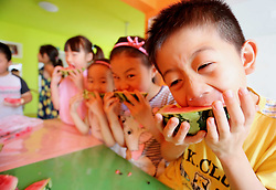 August 7, 2017 - Lianyungang, China - Children enjoy watermelons in Lianyungang, east China's Jiangsu Province, marking the solar term of Start of Autumn. It is a Chinese tradition to bite and enjoy fruits on the day of Start of Autumn. The traditional Chinese lunar calendar divides the year into 24 solar terms. Start of Autumn, the 13th solar term of the year, begins this year on Aug 7 and ends on Aug 22. Start of Autumn reflects the end of summer and the beginning of autumn. The fruitful season is approaching. (Credit Image: © SIPA Asia via ZUMA Wire)