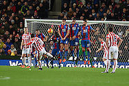 the Crystal Palace wall does it's job to block a free-kick by Xherdan Shaqiri of Stoke city.Barclays Premier league match, Stoke city v Crystal Palace at the Britannia Stadium in Stoke on Trent, Staffs on Saturday 19th December 2015.<br /> pic by Andrew Orchard, Andrew Orchard sports photography.