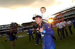 Gloucestershire's Tom Smith with his daughter - Mandatory byline: Robbie Stephenson/JMP - 07966 386802 - 19/09/2015 - Cricket - Lord's Cricket Ground - London, England - Gloucestershire CCC v Surrey CCC - Royal London One-Day Cup Final