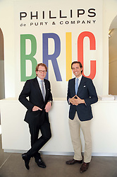 Left to right, FINN DOMBERNOWSKY and ALEX GILKES at the BRIC art sale preview (Brazil, Russia, India & China, the acronym BRIC here refers to the burgeoning contemporary art practices within these four countries.) organised by Phillips de Pury & Company at The Saatchi Gallery, London on 17th April 2010.