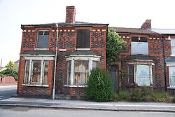 Row of boarded up derelict houses in the Bootle area; Liverpool England an area designated for the pathfinder regeneration scheme,