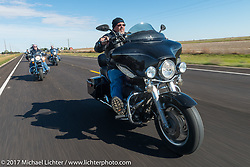 Mike Lenling of the Old Cronies in Aberdeen SD riding his Harley-Davidson Electra Glide Standard in the USS South Dakota submarine flag relay near Groton as it crosses South Dakota. USA. Sunday October 8, 2017. Photography ©2017 Michael Lichter.