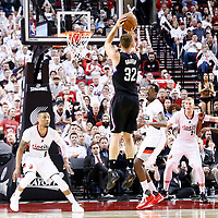 25 April 2016: Los Angeles Clippers forward Blake Griffin (32) takes a jump shot over Portland Trail Blazers forward Al-Farouq Aminu (8) and Portland Trail Blazers guard Damian Lillard (0) during the Portland Trail Blazers 98-84 victory over the Los Angeles Clippers, during Game Four of the Western Conference Quarterfinals of the NBA Playoffs at the Moda Center, Portland, Oregon, USA.