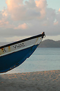 Rowboat pulled ashore at sunset, on the Caribbean island of Nevis, in the Lesser Antilles archipelago.