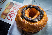 "13 AUGUST 2013 - HONG KONG:   Cronuts, the half donut/half croissant pastry developed by Chef Dominique Ansel for Dominique Ansel Bakery in New York City, are now available in Hong Kong. They are being sold under the ""cronut"" label by Swiss Beck on Cochrane Street in Hong Kong.    PHOTO BY JACK KURTZ"