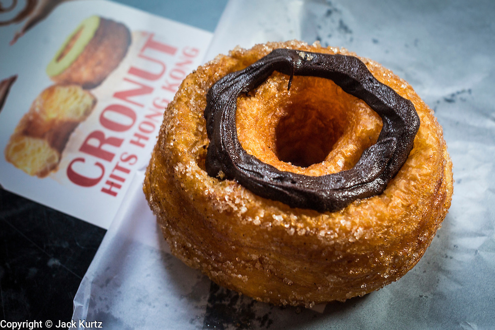"""13 AUGUST 2013 - HONG KONG:   Cronuts, the half donut/half croissant pastry developed by Chef Dominique Ansel for Dominique Ansel Bakery in New York City, are now available in Hong Kong. They are being sold under the """"cronut"""" label by Swiss Beck on Cochrane Street in Hong Kong.    PHOTO BY JACK KURTZ"""