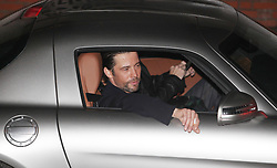 Jay Kay smokes a cigarette as he leaves after performing on this week's X Factor result show, at the Fountain studios, Wembley.