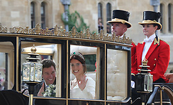 Jack Brooksbank and Princess Eugenie of York take a short procession in the Scottish State Coach after the wedding of Princess Eugenie to Jack Brooksbank at St George's Chapel in Windsor Castle.