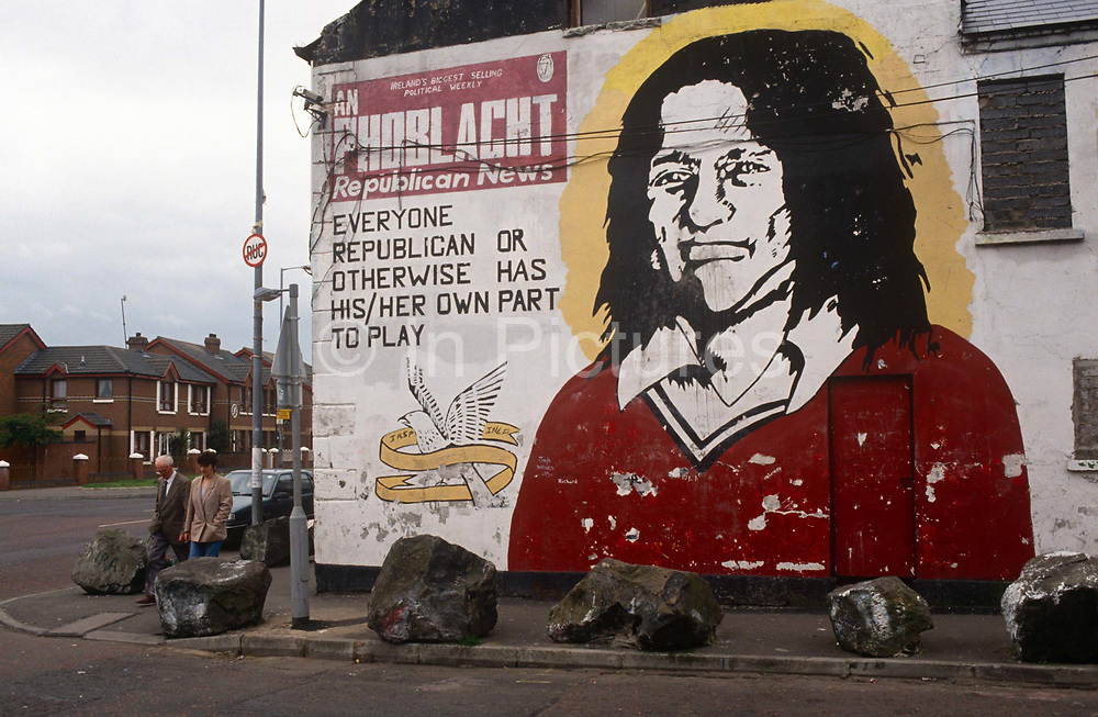 "The face of the Irish Republican Bobby Sands is painted on the office wall of Sinn Feinn, the left-wing politcal arm of the Irish Republican Army (IRA) in Belfast, Northern Ireland. Robert Gerard ""Bobby"" Sands (1954 – 1981) was an Irish volunteer of the Provisional Irish Republican Army and member of the British Parliament who died on hunger strike while imprisoned in HM Prison Maze. He was the leader of the 1981 hunger strike in which Irish republican prisoners protested against the removal of Special Category Status. During his strike he was elected as a member of the British Parliament as an Anti H-Block/Armagh Political Prisoner candidate."