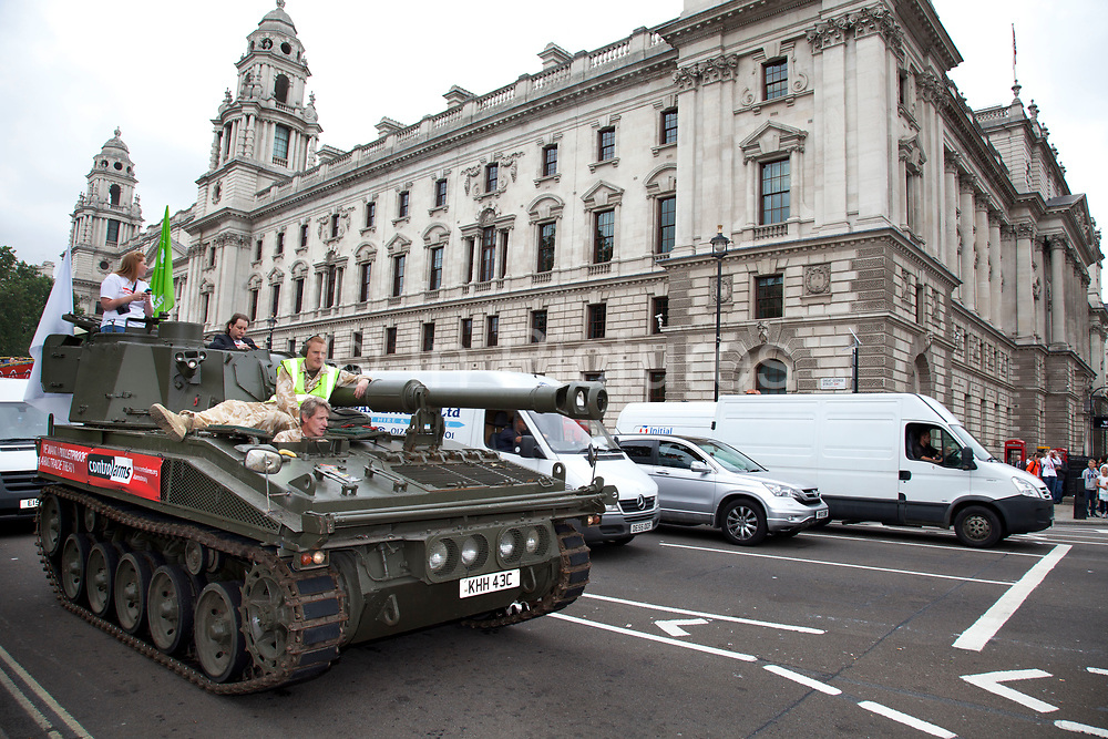 Tank passed through Parliament Square. Campaigners and supporters from Oxfam and Amnesty International, as part of the Control Arms coalition, drive an Abbot gun tank around central London to highlight the need for a global Arms Trade Treaty (ATT) to be agreed during a United Nations conference next month (July 2012). London, England, UK. 27th June 2012.