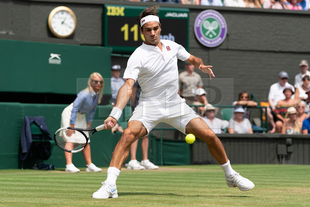 © Licensed to London News Pictures. 09/07/2018. London, UK.  Roger Federer of Switzerland plays Adrian Mannarino of France in the men's 4th round singles draw of the Wimbledon Tennis Championships 2018, at the All England Lawn Tennis and Croquet Club. Photo credit: Ray Tang/LNP