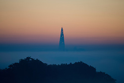 © London News Pictures. 06/10/2013. Richmond, London, UK.  The top of The Shard building pokes above early morning mist seen from Richmond Park, West London. The UK is experiencing an unusually warm start to the Autumn with temperatures reaching 20 degrees in parts.  Photo credit: Ben Cawthra/LNP