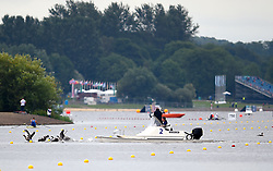 Water marshalls chase geese from the course during day two of the 2018 European Championships at the Strathclyde Country Park, North Lanarkshire.
