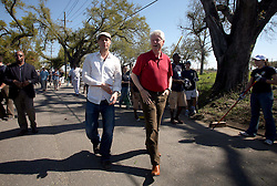 16 March 2008. New Orleans, Louisiana. Lower 9th ward.<br /> Former President Bill Clinton and movie star Brad Pitt with some of the 600 volunteers for the 'Make a Difference, Make a Commitment' clean up of the neighbourhood devastated by Hurricane Katrina. The massive clean up project was organised by Brad Pitt's Make it Right Foundation aided by the Clinton Global Initiative.<br /> Photo credit; Charlie Varley.