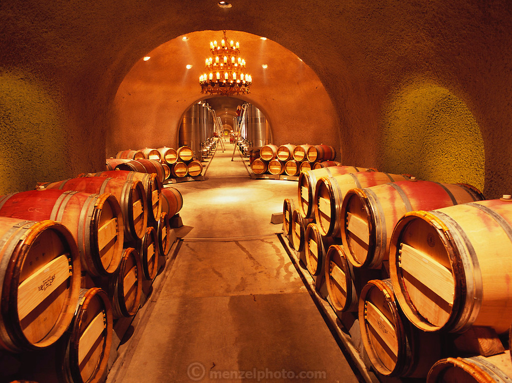 Far Niente Winery caves with oak barrels aging the wine. Napa Valley, California.