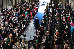 Princess Eugenie and Jack Brooksbank walk up the aisle at St George's Chapel in Windsor Castle after their wedding.