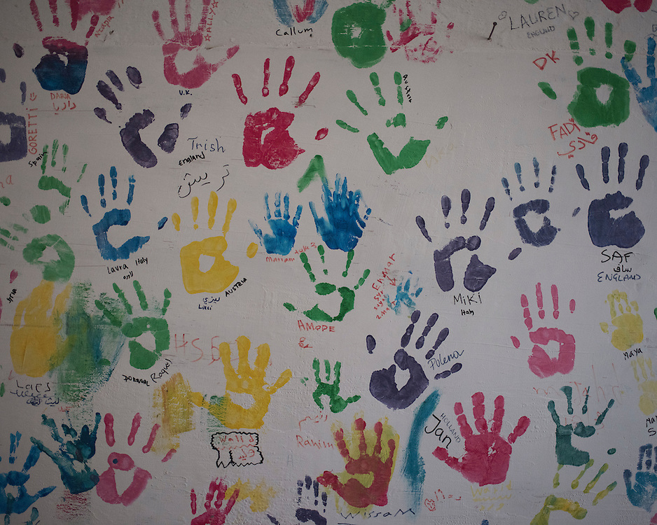 Children's handprints decorate a wall in the former refugee camp at the port of Lakki.<br /> <br /> The camp was opened by volunteers in the summer of 2015 and later that year UNHCR and MSF expanded it and provided additional tents, toilets and other facilities. The camp was closed soon after the opening of a 'Hotspot' (EU-run migrant's reception centres) camp in Lepida in February 2016.