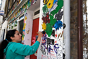 East London June 2009. Magdelena, Chilean artist , decorating gallery for  artists show, Redchurch Street, Shoreditch