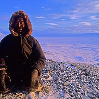 Apitak Iqaqrialu, an Inuit elder, sits on frozen tundra north of the Arctic Circle on Baffin Island, Nunavut, Canada.