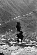 Hmong child over looking the mountains in the area of Sapa, Vietnam, Asia. 1996