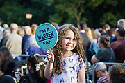 """New York, NY – 16 September 2019. Massachusetts Senator and Democratic Presidential candidate Elizabeth Warren drew a large and enthusiastic crowd at a speech for her increasingly popular 2020 presidential campaign in New York's Washington Square. A young girl holds up a fan that reads """"I'm a Warren Fan."""""""