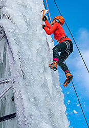 Dutch Ice Climbing Team athlete Marianne van der Steen in action. The ice is being sprayed against an old high-voltage pylon that NUON donated years ago to the climbing center near the Rijnhal. Making such an ice wall of 15 meters high, the highest ever in the Netherlands, requires a lot of patience and attention, but it really comes about drop by drop. Mountain climbers train on a vertical ice wall made in an electricity mast on february 12, 2021 in Arnhem