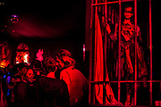 Stripper in cage. The Snake Pit night club. Glastonbury Festival 2010