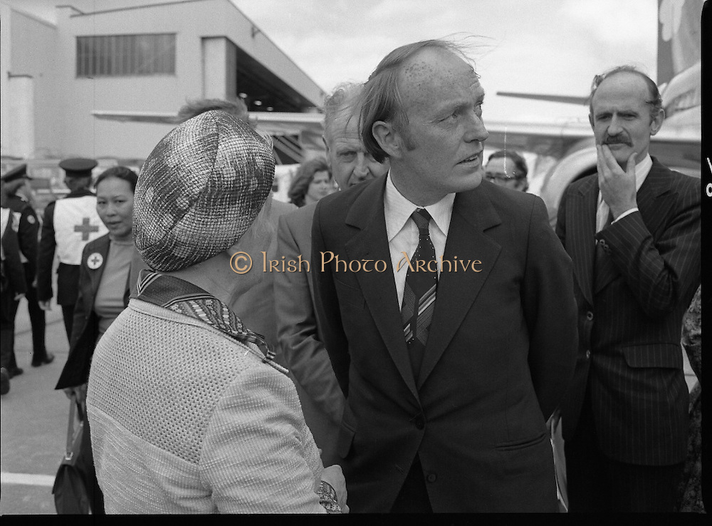 Vietnamese Refugees Arrive In Ireland.   (M85)..1979..09.08.1979..08.09.1979..9th August 1979..As part of an UNHCR initiative, Ireland agreed to take some of the Vietnamese (boat people) refugees into the country. A temporary refugee centre has been set up in the grounds of Blanchardstown Hospital to accomodate the families, from where they will be assimilated into the community..Picture shows the Minister for Foreign Affairs, Mr Michael O'Kennedy TD, and his officials on hand to greet our new citizens.