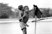 BURMA (MYANMAR) Yangon Division, Thanlyin. For these brothers, life close to the Thanlyin River means at least some relief from the fierce heat that grips Burma most of the time.