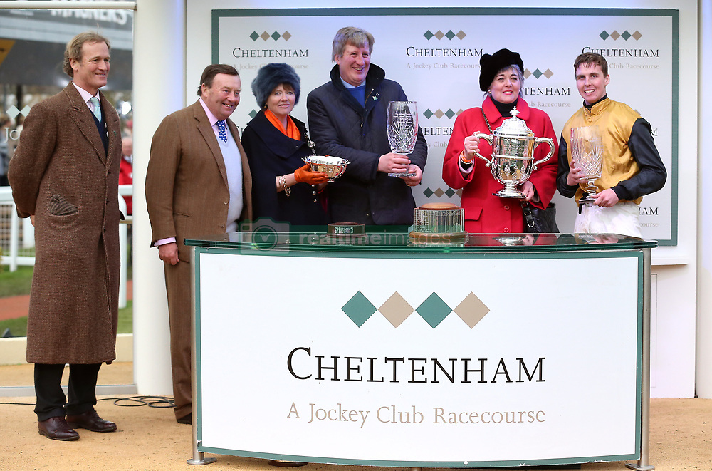 Trainer Ben Case (centre), owner Lady Jane Grosvenor and jocky Kielan Woods (right) after victory at the Johnny Henderson Grand Annual Challenge Cup Handicap Chase during Gold Cup Day of the 2019 Cheltenham Festival at Cheltenham Racecourse.