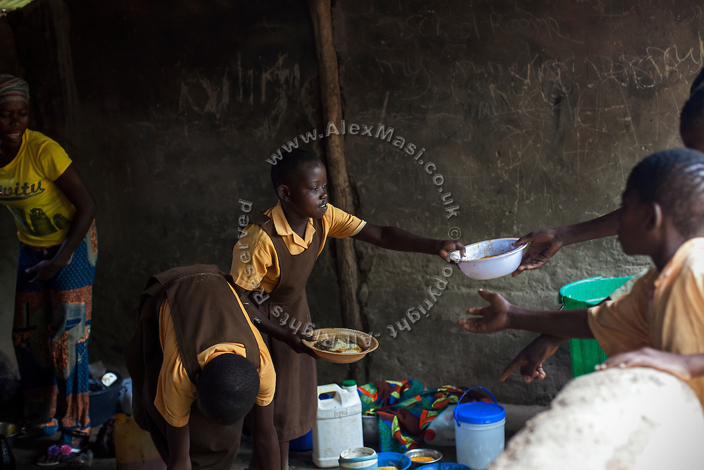 Older pupils are helping in distributing the nutritional meals available under the School Feeding Program run by the local NGO SEND at the small rural institution that Hassana Ibrahim, 11, is attending, in Boggu, Tamale, northern Ghana.