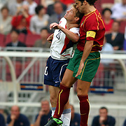 USA's Brian McBride jumps for the ball with Portugal's Fernando Couto